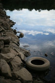 Polluted Lake with Discarded Tire — Stock Photo