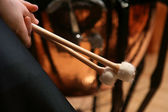 Pair of hands holding drumsticks — Stock Photo