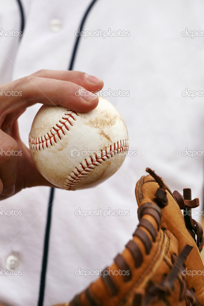 Pitcher showing how to grip the baseball — Stock Photo #2919280
