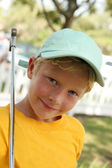 Boy Putt Putt Golf in Blue Cap — Stock Photo