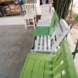 Green wood village chairs — Stock Photo