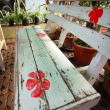 Stock Photo: Rustic bench with flowers