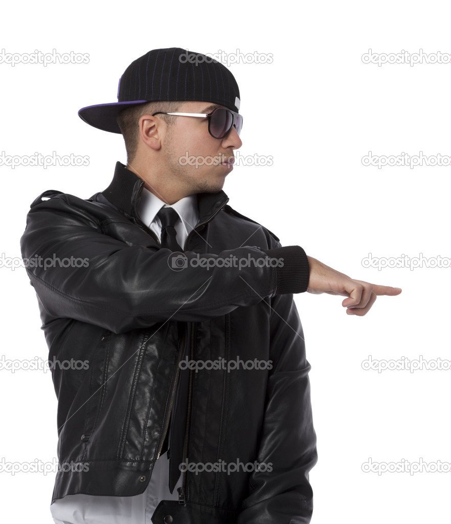 Studio photo of trendy young man looking sideways, pointing. White background. — Stock Photo #3256662