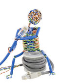 Twisted man looks on patch cable — Stock Photo