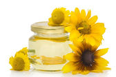 Cosmetic oil from yellow flowers — Stock Photo