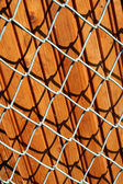 Wooden panels behind a lattice — Stock Photo