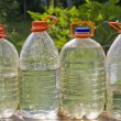 Stock Photo: Canisters, bottles with pure water