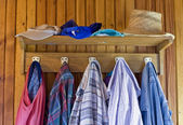 Old clothes in the old house — Stock Photo