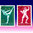Two postage stamps to blue and pink back — Stock Photo