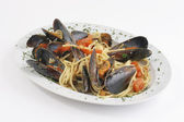 Pasta with mussels — Stock Photo