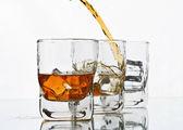 Pouring whiskey — Stock Photo
