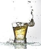 Yellow drink splash — Stock Photo