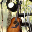 Acoustic guitar on the scene — Stock Photo