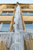 Gutter with ice — Stock Photo