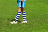 Soccer player's legs — Stock Photo