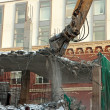Heavy dredger demolishes building - Stock Photo