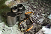 Binoculars with map — Stock Photo