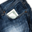 Stock Photo: Jeans pocket with one hundred dollars banknotes