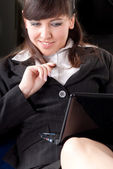 Young business woman working with a laptop — Stock Photo