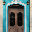 Elegant front door with lamps — Stock Photo
