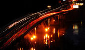 Night traffic on the bridge — Stock Photo