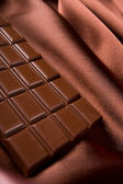 Chocolate and silk — Stock Photo