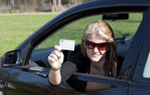 Woman shows proudly her new driving licence — Stock Photo