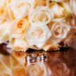 Stock Photo: Wedding bouquet and rings.
