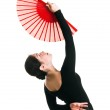 Beautiful dancer girl with a red fan — Stock Photo #3026251