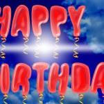 Happy birthday balloons on blue sky — Stock Photo