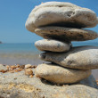 Balanced stones on beach — Stock Photo