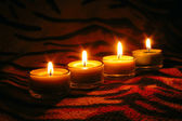 Raw candles on striped surface — Stock Photo