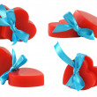 Stock Photo: 4 groups of pairs of red hearts