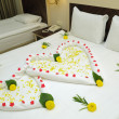 Bed Suite decorated with flowers and towels. — Stock Photo