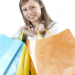 Young woman holding several shoppingbags - Stock Photo