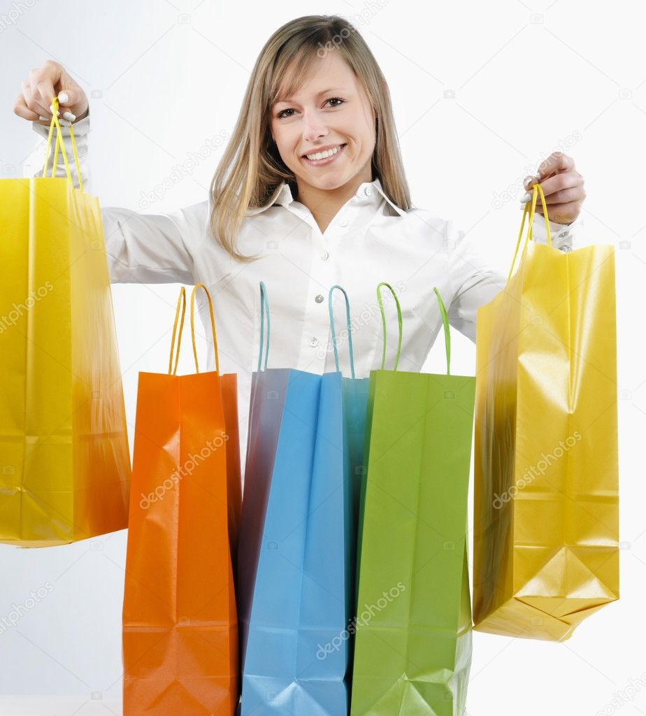 Portrait of an attractive young woman holding several shoppingbags.  Stock Photo #2873770
