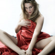 Blonde girl with red silk - Stock Photo