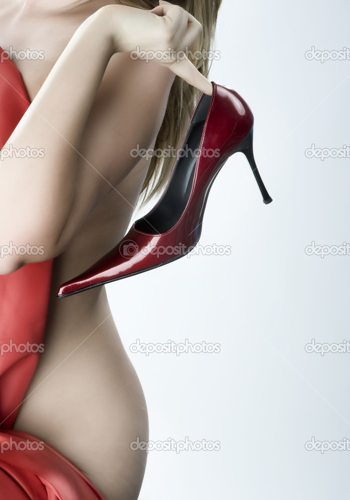 Blonde woman with a red shoe in his hand — Photo #2924387