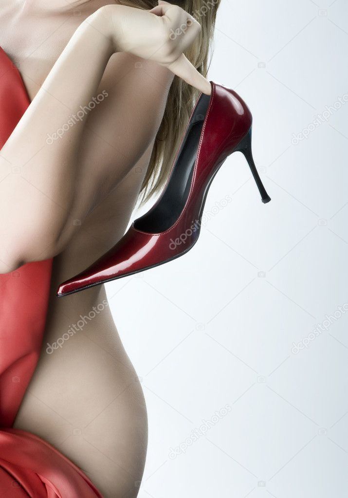 Blonde woman with a red shoe in his hand — Foto Stock #2924387