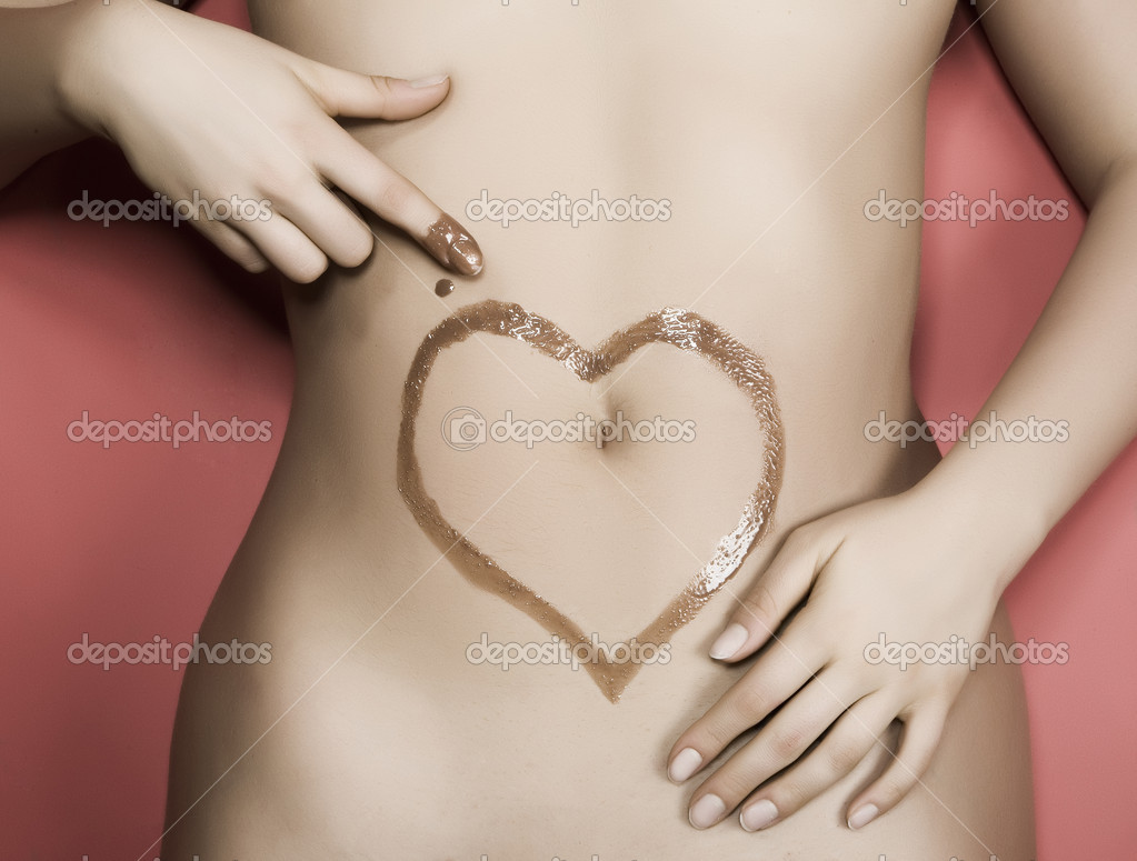Chocolate heart drawn on the belly of a woman — Stock Photo #2924476