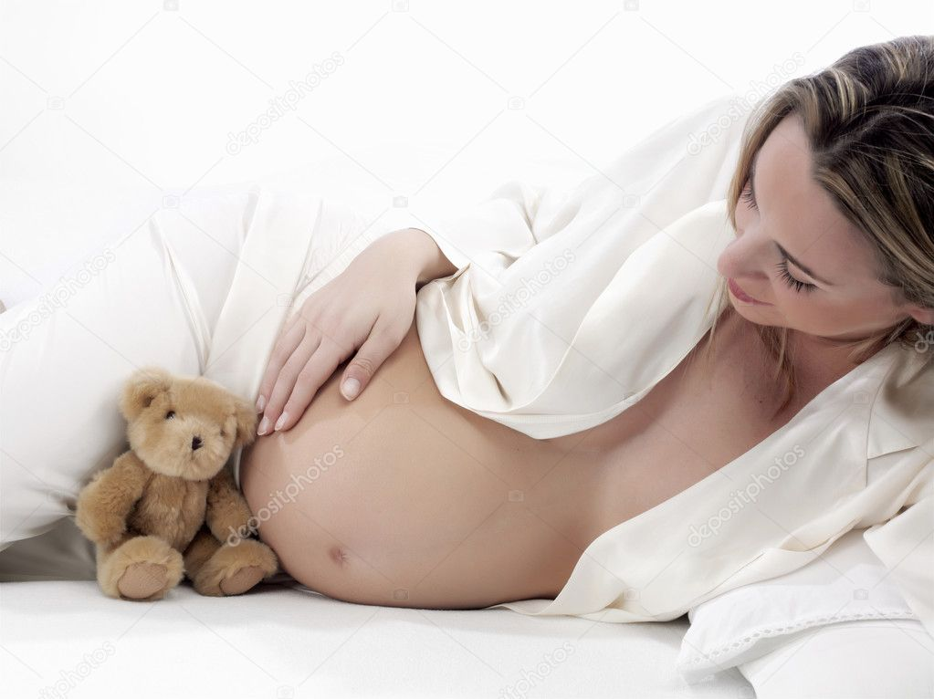 Pregnant with bear in bed on a white background  Stock Photo #2926635