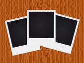 Set of polaroid on wood texture — Stock Vector