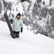 Stock Photo: Snowboarder in deep snow