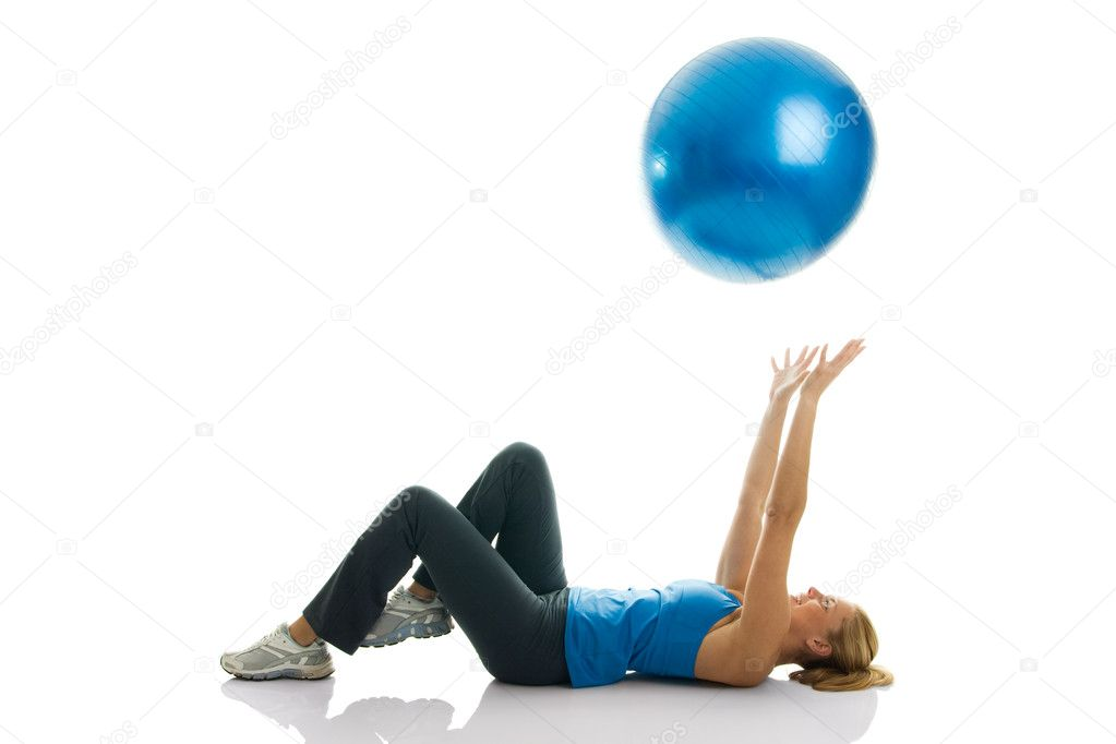 Young women playing with a fitness ball. Isolated on white — Stock Photo #2979629