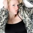 Fashionable teenage girl in fur coat - Foto Stock