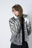 Fashionable teenager girl in fur coat — Stock Photo