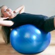 Young women doing crunches on fitness ball — Stock Photo #3342586