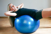 Young women doing crunches on fitness ball — Stock Photo