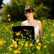 Stock Photo: Young girl using laptop