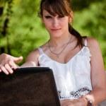 Beautiful girl using laptop — Stock Photo #3423281